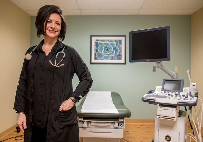 Carrie Horack, a nurse practitioner and downstate lead clinician for Planned Parenthood, poses in an examination room at the Planned Parenthood Health Center, 2709 N. Knoxville Ave., Peoria.