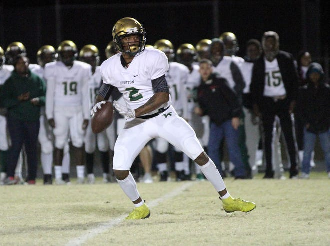 Kinston quarterback Demitri Holmes is back for a senior season in which he and the Vikings hope to make the playoffs in a shortened season.