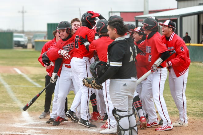 Shallowater's Breken Ramos (8) is mobbed at home plate after hitting a home run against Lamesa during the Shallowater Railyard Classic on Thursday, Feb. 25, 2021, at Garland Field in Shallowater, Texas.