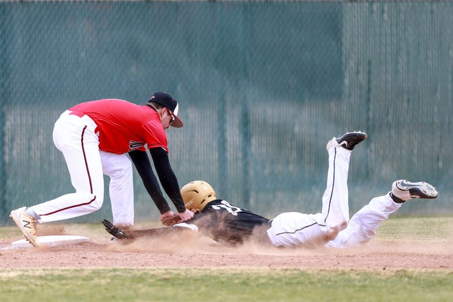 Shallowater's Huston Briseno (6) tags out Lamesa's Christian Ruiz (20) at third base during the Shallowater Railyard Classic on Thursday, Feb. 25, 2021, at Garland Field in Shallowater, Texas.