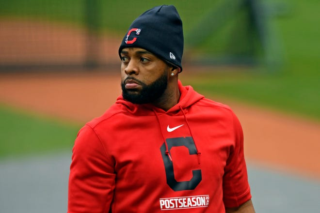 FILE- In this Sept. 29, 2020, file photo, Cleveland Indians' Carlos Santana exits the batting cage before Game 1 of an American League wild-card baseball series against the New York Yankees in Cleveland.