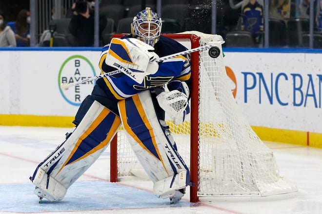 St. Louis Blues goaltender Jordan Binnington blocks a shot during the third period of the team's NHL hockey game against the Los Angeles Kings on Wednesday, Feb. 24, 2021, in St. Louis.