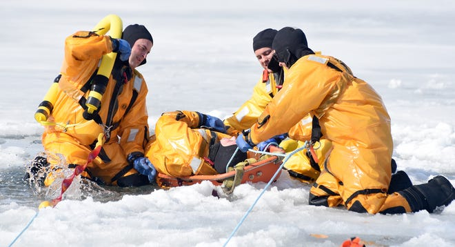 Frenchtown Fire Department Lt. Josh Volker is rescued by firefighters Cory Guy, James Compora, and Neil Hawley during training on ice rescues at Sterling State Park on Wednesday with Capt. Mike Keith, Capt. Joe Smigielski and firefighter Cory Musko. [MONROE NEWS PHOTO BY TOM HAWLEY]