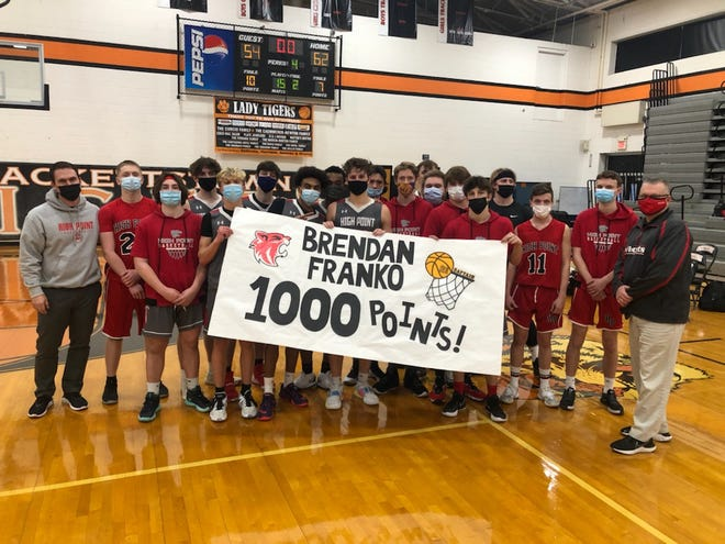 High Point forward Brendan Franko, center, celebrates becoming the Wildcats' eight boys player to reach 1,000 points on Feb. 23, 2021, with a 40-point effort in a 62-54 loss against Hackettstown at Hackettstown High School.