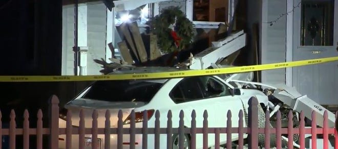 A car crashed into a home in Randolph on Wednesday, Feb. 24, 2021.