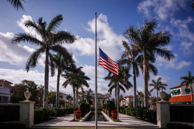 Flags at Palm Beach Town Hall fly half-staff on Wednesday.
