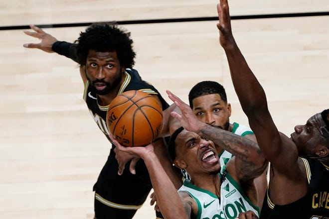 Boston Celtics guard Jeff Teague (55) goes up for a shot against Atlanta Hawks center Clint Capela (15) in the second half of an NBA basketball game Wednesday, Feb. 24, 2021, in Atlanta. (AP Photo/John Bazemore)