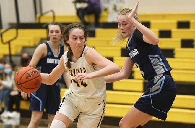 The Garfield Lady G-Men hosted the Rootstown Rovers for a district semifinal showdown. Garfield sophomore Madeline Shirkey drives to the basket to score.