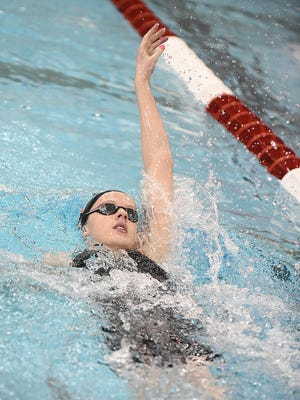 Claire Cox of Marlington swims the backstroke leg of the 200 Yard Medley  at the Girls Division II State Swimming Wednesday , February 24, 2021.