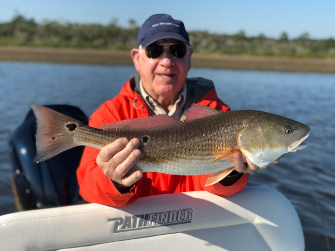 John Jackson with a slot redfish caught with Captain Tommy Derringer this week.