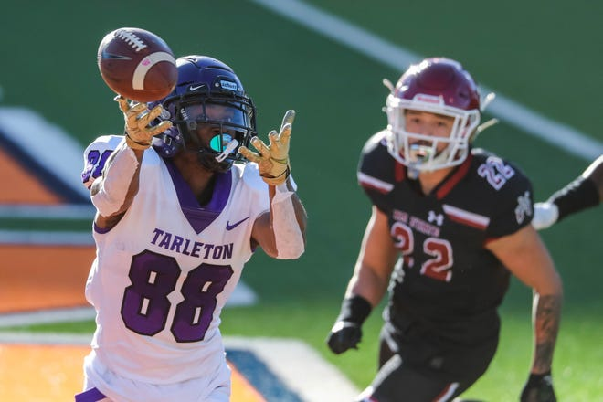 Tarleton's J.F. Thomas (88) reaches for a pass during the Texans' game against the New Mexico State Aggies at the Sun Bowl in El Paso on Sunday.
