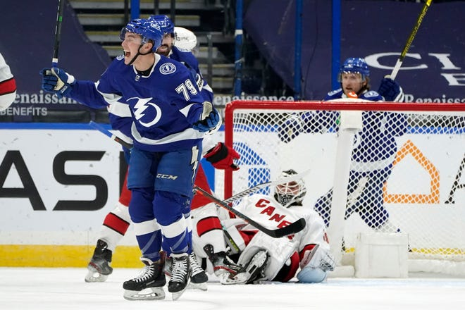 Tampa Bay Lightning forward Ross Colton (79) celebrates after scoring past Carolina Hurricanes goaltender Alex Nedeljkovic (39) during the first period of an NHL hockey game Wednesday, Feb. 24, 2021, in Tampa, Fla. (AP Photo/Chris O'Meara)