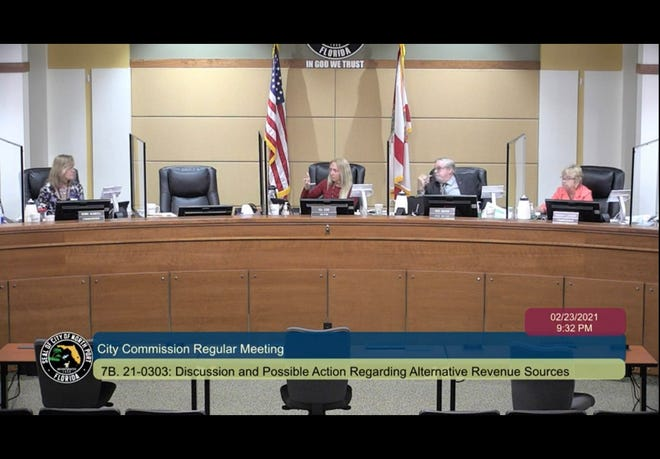 North Port City Commissioners decided against adopting public service taxes and fees to generate additional revenue. Pictured from left: City Commissioner Debbie McDowell, Mayor Jill Luke, Vice Mayor Pete Emrich, and Commissioner Barbara Langdon.