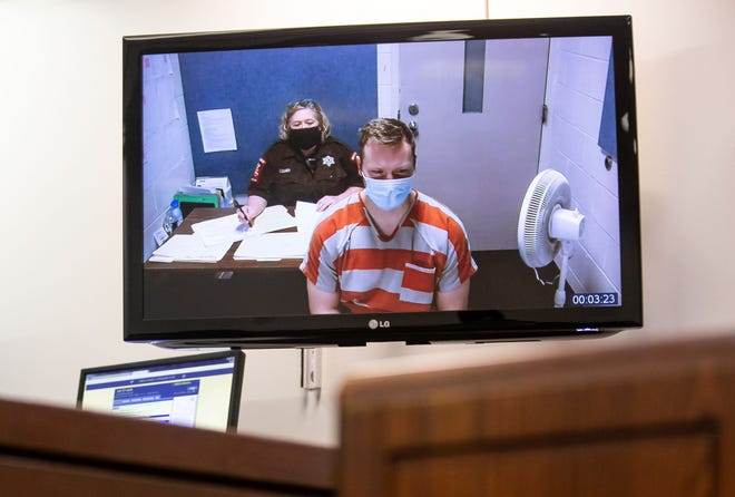 Springfield Police Officer Taylor Staff appears via video from the Sangamon County Jail in front of Judge Jennifer Ascher on charges of criminal sexual assault, three counts of official misconduct and custodial sexual misconduct at the Sangamon County Complex in Springfield, Ill., Thursday, February 25, 2021. Staff, who has been with the department for a little over three years, was arrested following an investigation by the Illinois State Police and has been placed on unpaid administrative leave pending the outcome of the SPD's internal affairs investigation. [Justin L. Fowler/The State Journal-Register]
