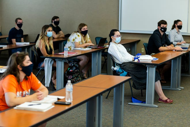 Students stay six feet apart while wearing face masks in Professor Dave Saner's accounting information systems class on the the first day of classes at the University of Illinois Springfield, Monday, August 24, 2020, in Springfield, Ill. [Justin L. Fowler/The State Journal-Register]