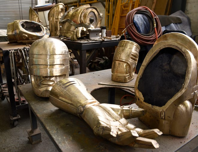 FILE - In this Sept. 19, 2017, file photo, body parts for a RoboCop statue are displayed in sculptor conservator Giorgio Gikas' studio in Detroit. The Detroit News reports that the Michigan Science Center announced Wednesday, Feb. 24, 2021, that it no longer plans to be home to the 11-foot-tall bronze RoboCop statue. (Clarence Tabb Jr./Detroit News via AP, File)
