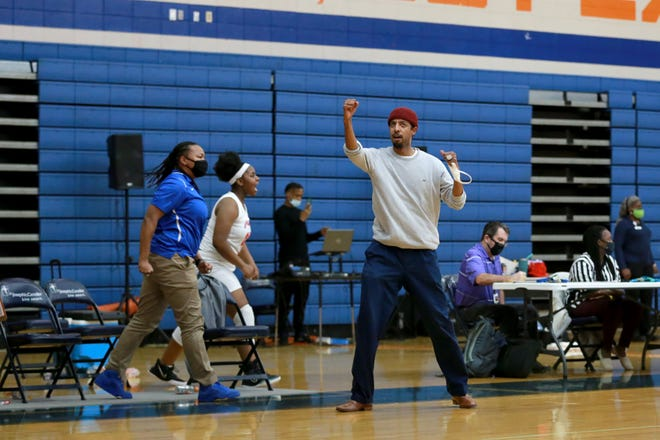 Johnson girls basketball coach Brandon Lindsey celebrates as his team makes a soring run during Wednesday night's first-round playoff game against Pike County at Johnson High School.