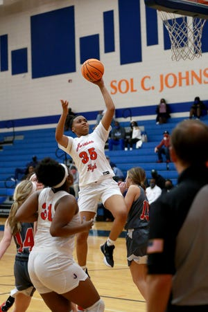 Johnson's K'Lya Hankerson slices to the basket during Wednesday's first-round playoff game against Pike County.