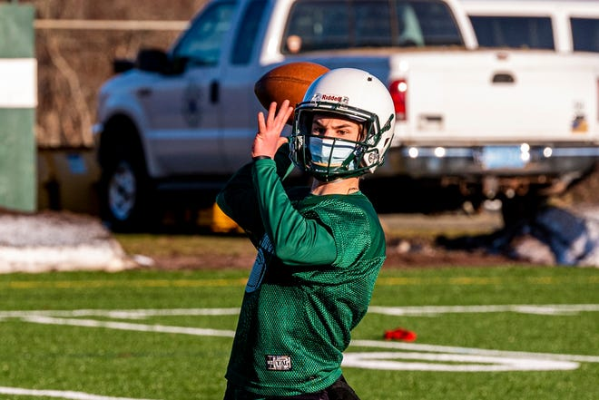 Will Kelly looks to hit a receiver on the sidelines during offensive drills at Dartmouth Football practice.