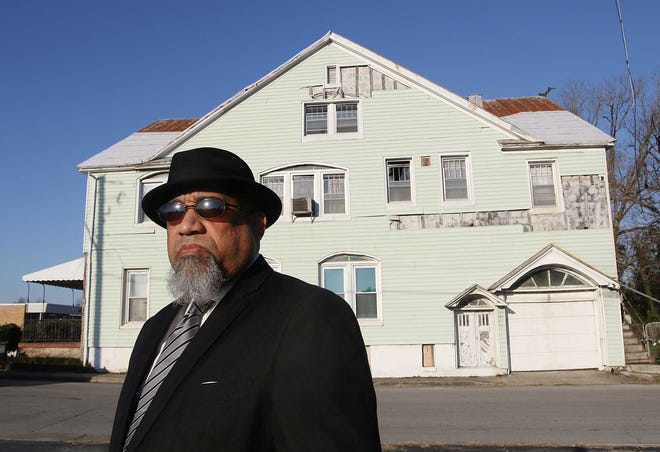 Leander Morgan Jr. stands near the historic Rivers Funeral Home at 1102 Broad St. in New Bern, NC. The Rivers Funeral Home was in operation from the 1940s to the 1980s, then relocated to 701 West St. as Rivers–Morgan Funeral Home.