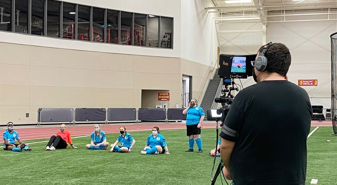 """The cast of PSU's new play """"The Wolves"""" wait for the cameras to be set up at the Plaster Center Monday night. The play is completely virtual and will premiere March 4."""