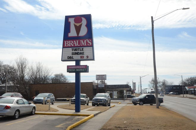 A customer pulls into the parking lot at Braum's on South Broadway in Pittsburg. Braum's is located just north of a vacant building (in background) that the City of Pittsburg, which owns the property, has approved for demolition.