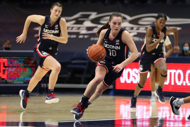 UConn guard Nika Muhl (10) drives up court against Xavier during the Huskies' 83-32 win.