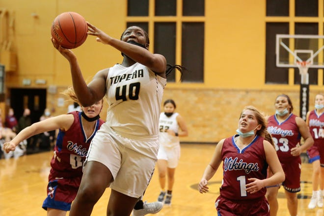 Topeka High's NiJaree Canady led the city girls in scoring, averaging 20.4 points per game for the Centennial League champion Trojans.