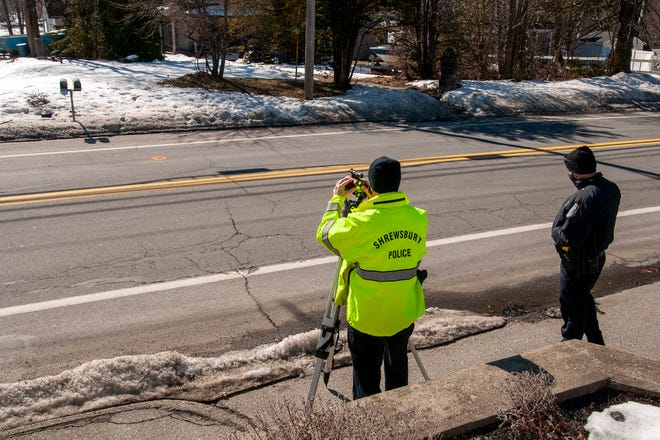 Investigators at the scene of the pedestrian accident on South Quinsigamond Road in Shrewsbury on Thursday.