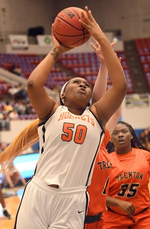 Hawthorne's Mya McGraw shoots against Trenton in their Class 1A semifinal  Wednesday during the Florida High School State Championship at The Lakeland Center in Lakeland. Hawthorne defeated Trenton 43-32 to advance to tonight's title game.