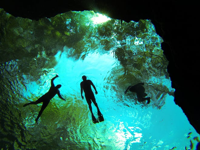 People snorkel in the water of the Devil Spring system at Ginnie Springs near High Springs in 2013.