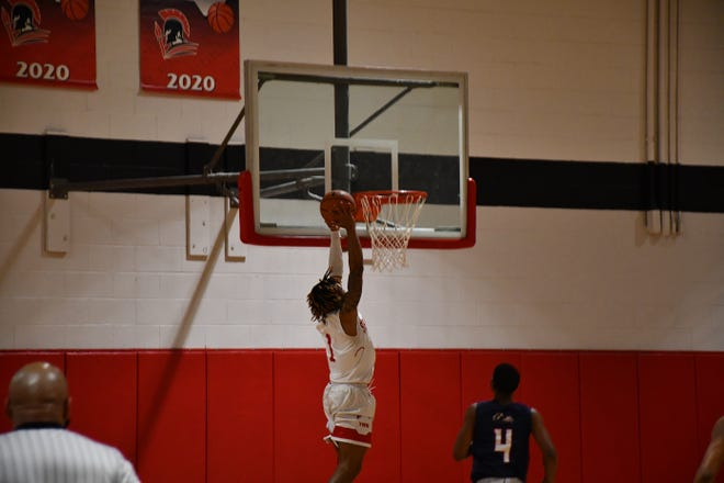 The Burlington School's Jamarii Thomas elevated for a dunk against Wayne Country Day on Wednesday night.
