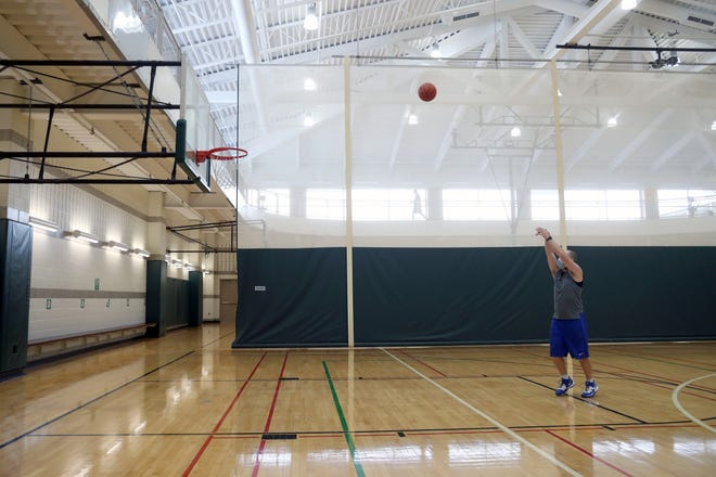Brian Duffy, 36, of Dublin shoots a basketball at the Dublin Community Recreation Center on Feb. 24.