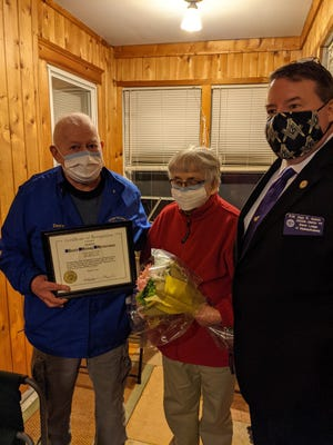 """Pictured from left to right are Wor. David Westerman, his wife Ella, and R.W. Alan Welch, D.D.G.M., who represents the grand master in the William Sutton Masonic Lodge district. A fun evening at his home and a few stories from the """"old days"""" was enjoyed by all in attendance!"""