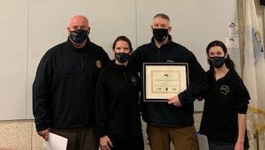 Pictured, from left: Brookline Police Sgt. Chris Malinn, Brookline Police Lt. Jennifer Paster, Braintree Police Officer Jay St. Ives and clinician Annabel Lane.