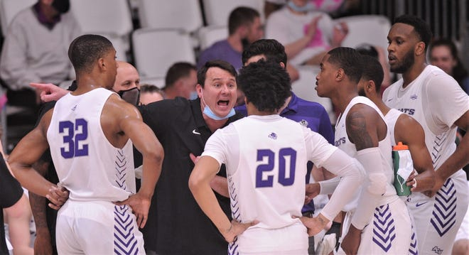 ACU coach Joe Golding talks to his team during a timeout against Sam Houston State. ACU beat the Bearkats 86-72 in the Southland Conference game Feb. 24 at the Teague Center.