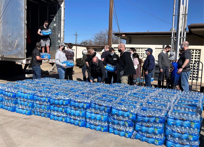 Water is unloaded Feb. 21 from a semi at the Church of Jesus Christ of Latter-day Saints. The church's effort reflected others in Abilene to help those still reeling from the month's winter storm.
