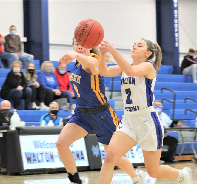 """NCC senior Annie Heck and Walton-Verona senior Haylee Neeley battle for the ball as Walton-Verona defeated Newport Central Catholic in the first round of the All """"A"""" Classic girls basketball state tournament Feb. 24, 2021, at Walton-Verona High School, Walton, Ky."""
