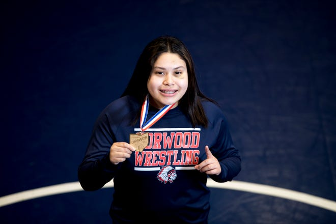 Norwood's Lizbeth Banderas-Rodriguez was looking for a sport to play when she heard an announcement congratulating the school's wrestling team for a successful season.