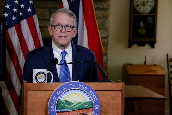 Gov. Mike DeWine skipped a meeting of the Ohio Redistricting Commission to attend Bengals training camp.