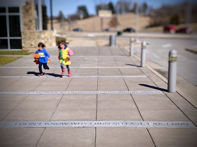 Max (left), 6, runs next to his sister, Kat, 7. Her brother and mother, Allison, traveled to Clarksville this week to learn up-close about Wilma Rudolph, who won three gold medals at the Rome Olympics in 1960.