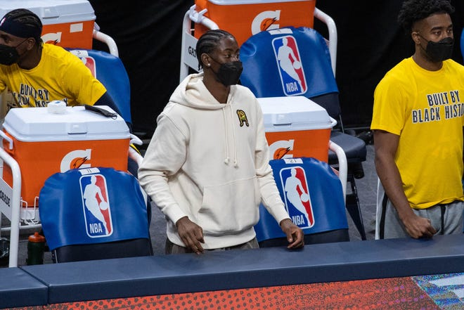 Feb 24, 2021; Indianapolis, Indiana, USA; Indiana Pacers guard Caris LeVert (22) watches the game from the bench due to injury in the fourth quarter against the Golden State Warriors at Bankers Life Fieldhouse. Mandatory Credit: Trevor Ruszkowski-USA TODAY Sports
