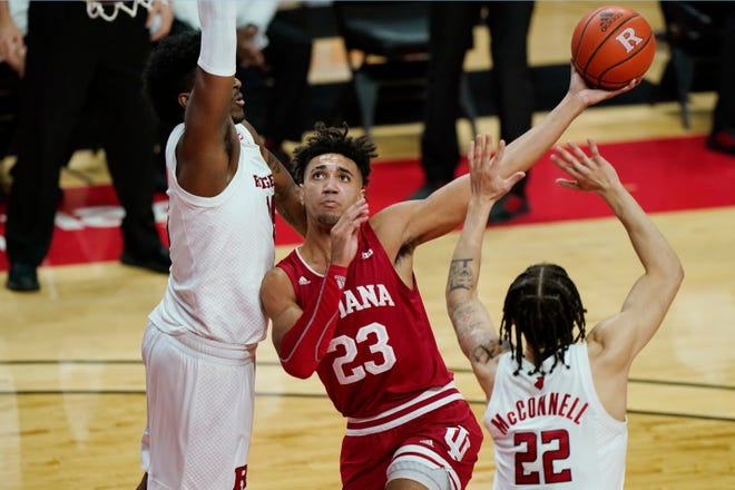 Indiana forward Trayce Jackson-Davis (23) looks to shoot with Rutgers center Myles Johnson, left, and guard Caleb McConnell (22) defending during the first half of an NCAA college basketball game Wednesday, Feb. 24, 2021, in Piscataway, N.J.