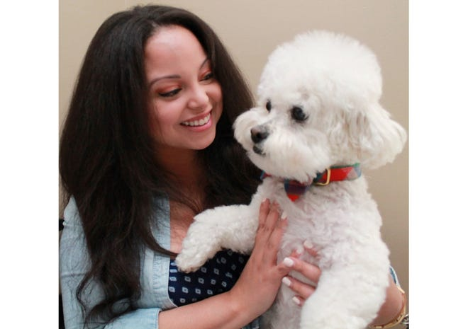 """After Jalina Colón adopted her fluffy dog Henry, he became an inspiration for her work in design. """"We rescued each other,"""" she says."""
