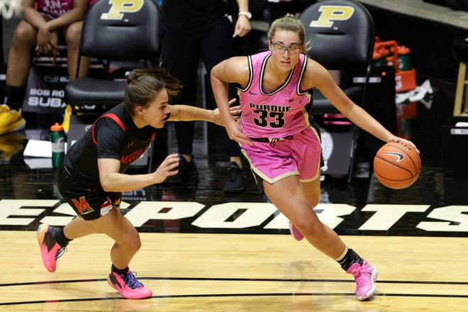 Purdue guard Madison Layden (33) dribbles against Maryland guard Katie Benzan (11) during the first quarter of an NCAA women's basketball game, Thursday, Feb. 25, 2021 at Mackey Arena in West Lafayette.