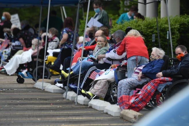 Lexington Court Care Center residents enjoy a distanced parade.