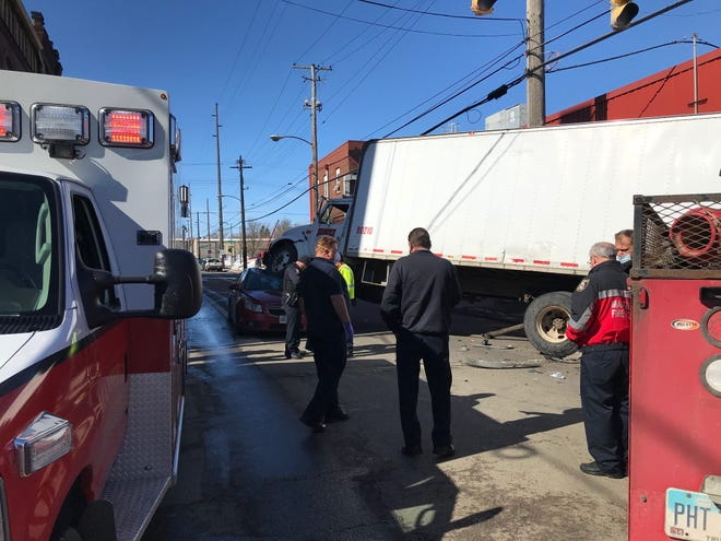 A box truck and a car collided at Fifth and Diamond streets Thursday morning, resulting in the truck's front driver's side tire coming to rest atop the car's crushed roof. Mansfield police and firefighters responded to the scene. The crash report was not available Thursday. One person claimed injury.