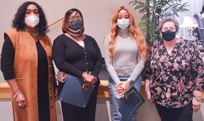 The Montgomery County Board of Education named Natasha Broaden and Nikki Martin its Employees of the Month during their February meeting. From left are Superintendent Ann Roy Moore, Broaden, Martin, and Board President Clare Weil.