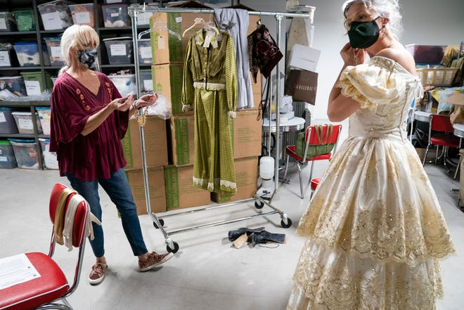 "Mary Anne McKerrow, left, costume coordinator, helps Leah Partridge, who will play Violetta in Opera Naples' rendition of Verdi's La Traviata, get into costume at the Wang Opera Center in Naples on Thursday, February 25, 2021. Opera Naples' ""Festival Under the Stars"" will be held outdoors at Baker Park from March 10-13."