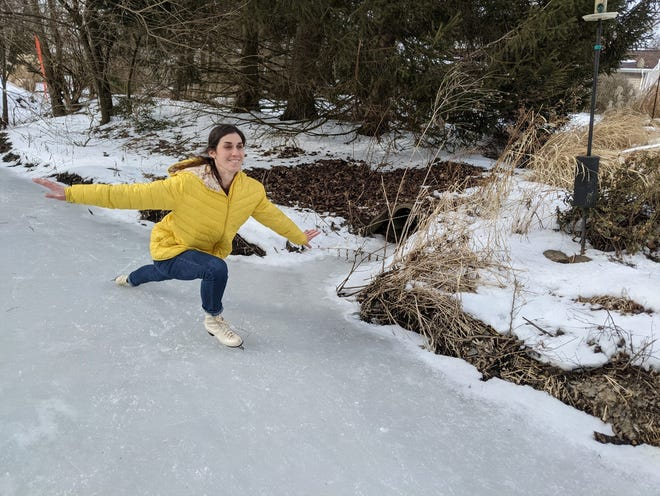 Abbey Roy demonstrates her newly learned skating skills after taking skating lessons for adults.